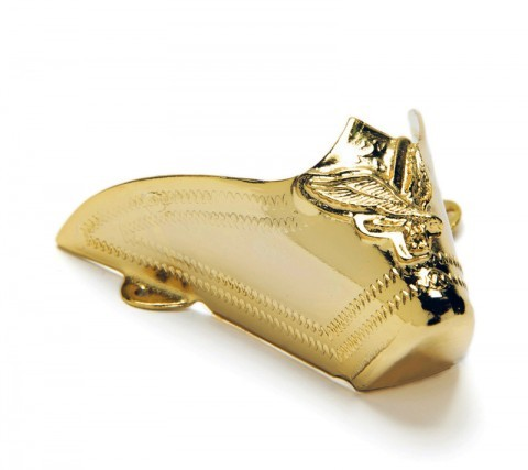 Decorative golden metal tips for western boots with embedded eagle