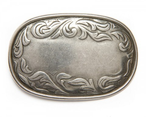 Western style rectangular silver metal belt buckle with engraved filigree scroll